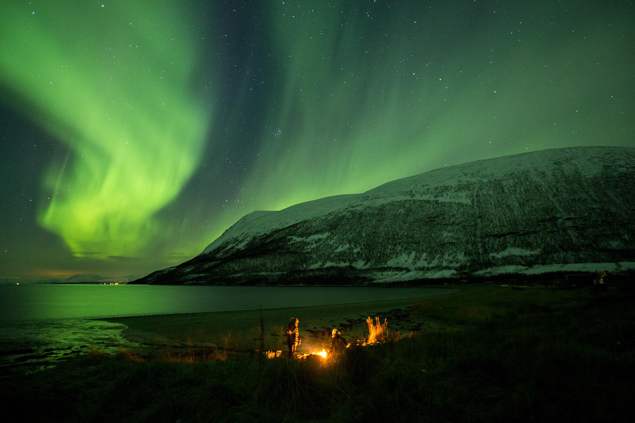 Campfire with aurora