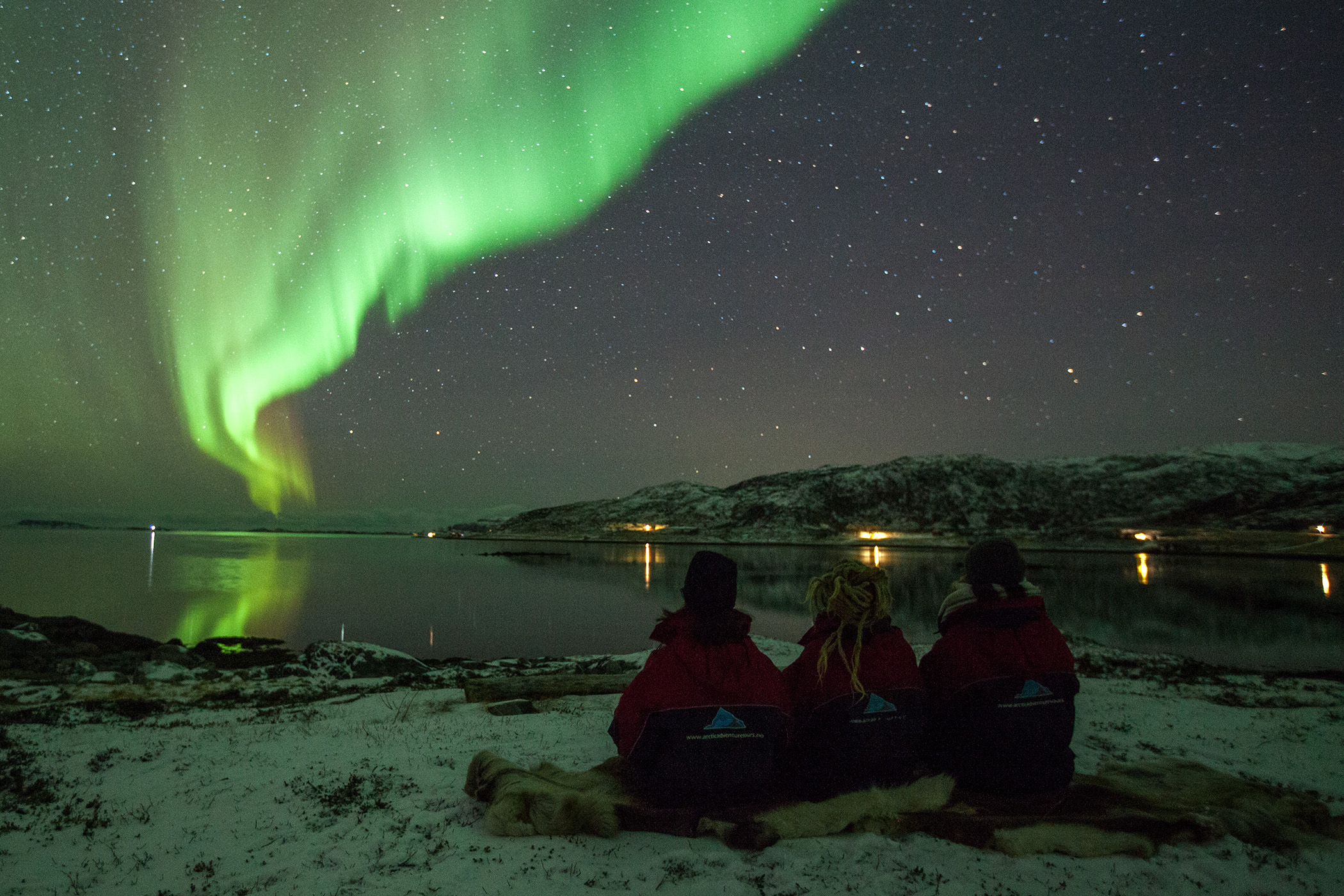 Group with northern lights