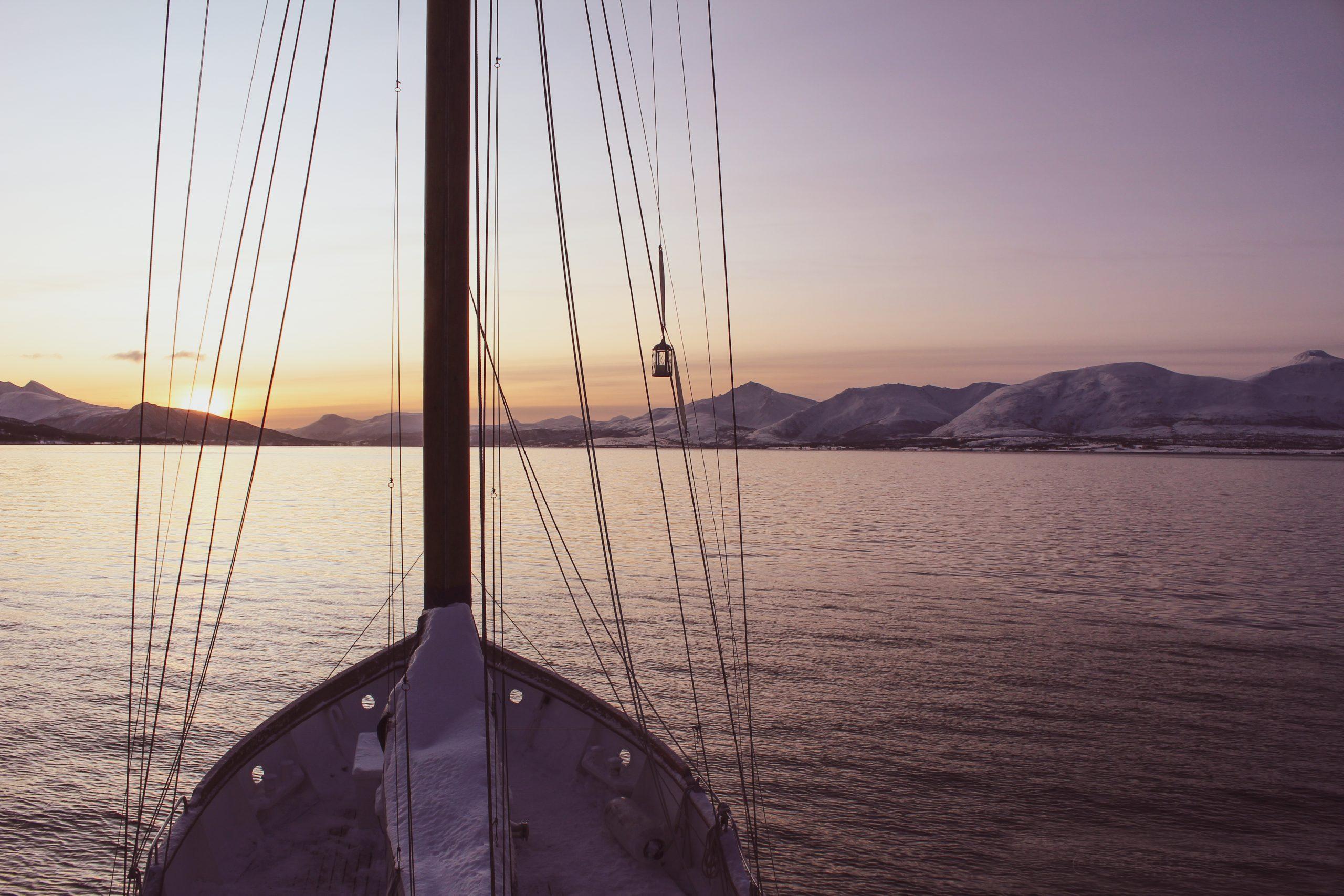 sunrise onboard stella oceana sailing boat tromso